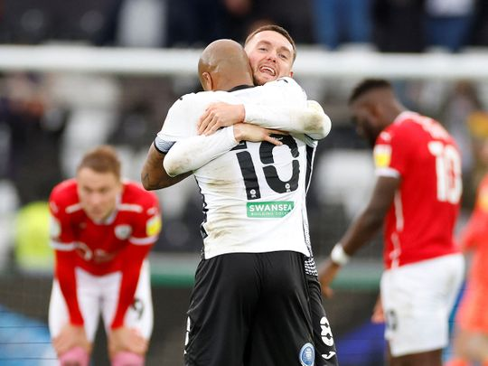 Swansea City's Matt Grimes and Andre Ayew celebrate after defeating Barnsley