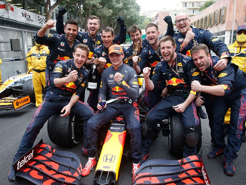 Red Bull driver Max Verstappen celebrates with his team after winning the Monaco Grand Prix