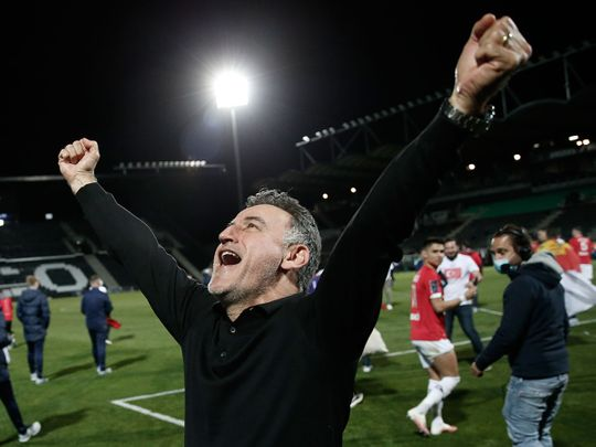 Lille's head coach Christophe Galtier celebrates after winning the Ligue 1 title