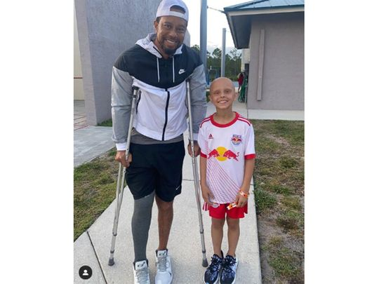 Tiger Woods with young fan Luna Perrone