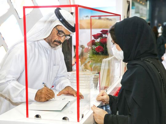 Bin Dalmook - HHC Ceo during the book signing ceremony at ADIBF-1622301066529