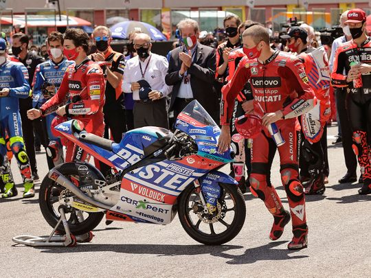 Ducati Lenovo Team's Jack Miller pays his respects to Moto3 rider Jason Dupasquier who died from injuries sustained in qualifying at Mugello ahead of the Italian Grand Prix