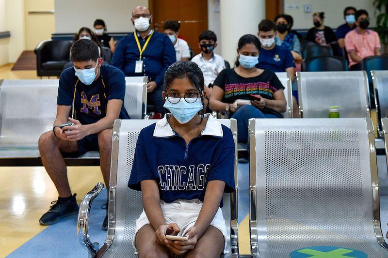 Children gets vaccinated against COVID-19 at Al Barsha Health Centre in Dubai.