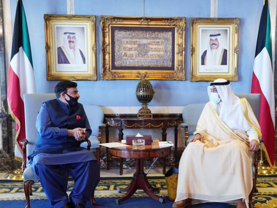 Minister for Interior Sheikh Rasheed Ahmed (L) meets Kuwaiti Prime Minister Sabah Al-Khalid Al-Sabah