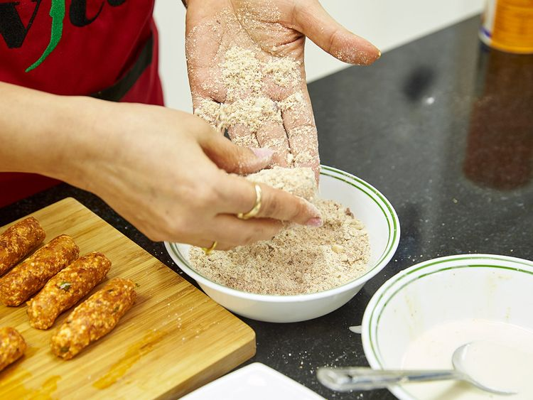Coat the kabab with almond powder