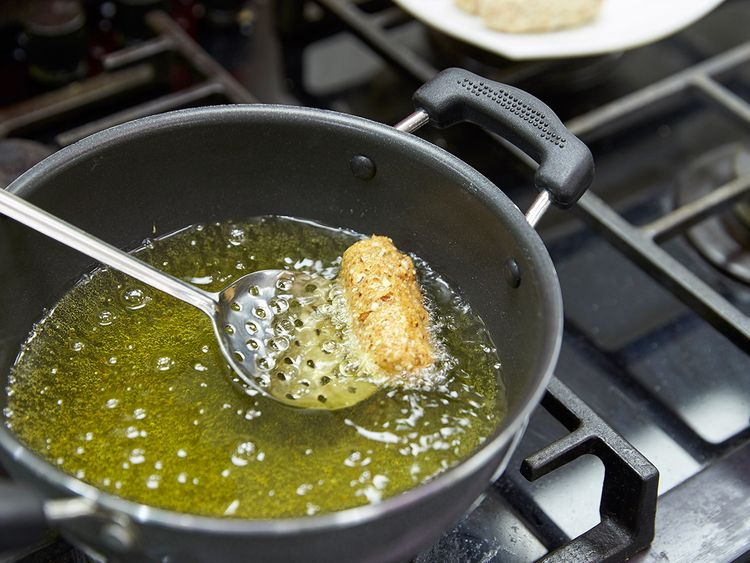 Collect the kabab in the frying ladle