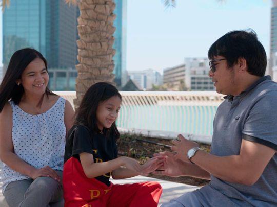 Daina Bautista with family-1622543982421