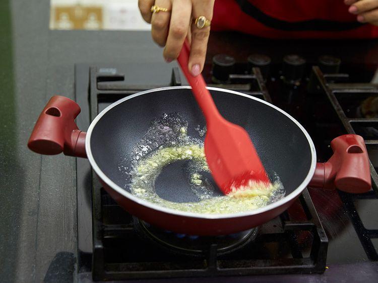 Sauté garlic until golden brown