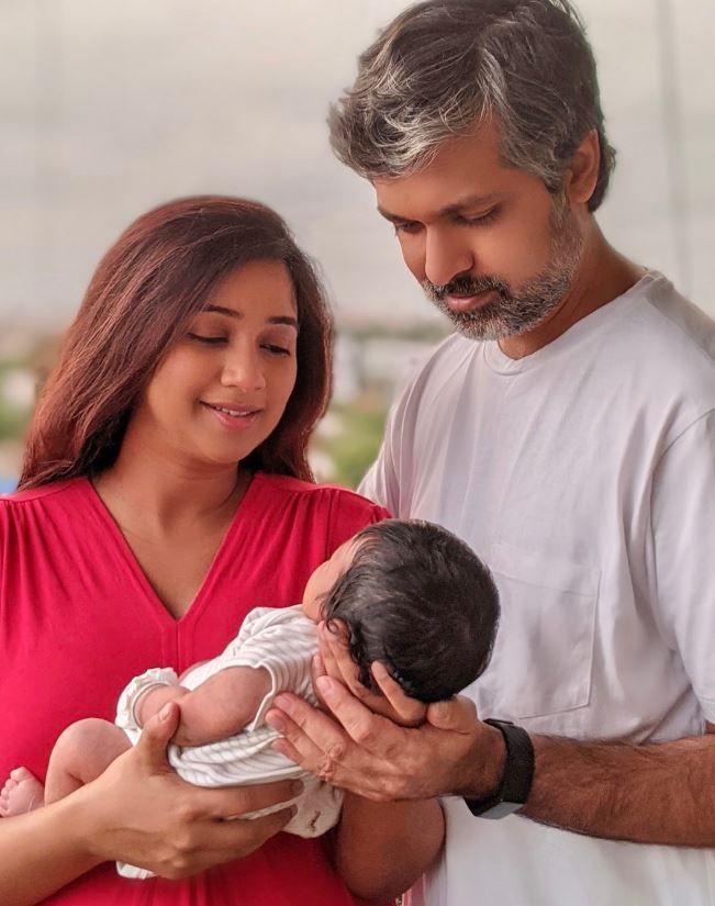 Shreya Ghoshal with her husband and newborn