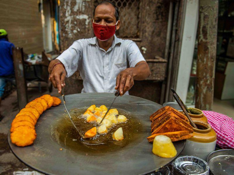 Street vendor making aloo chaat