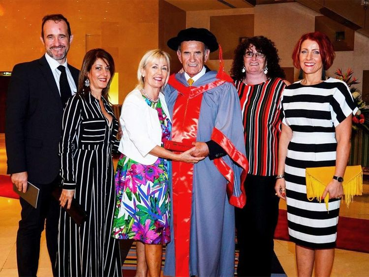 Colm McLoughlin celebrated with his family after receiving an Honorary Doctorate  in this 2017 file photo. His wife Breeda, son Niall and Sherly McLoughlin, Tyna McLoughlin and Amanda Jordan are seen in the photo.