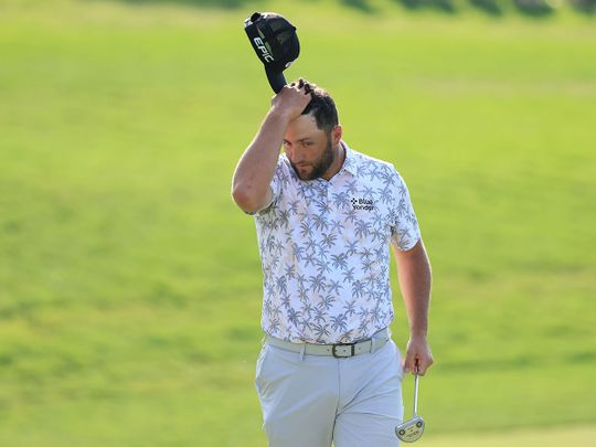 Jon Rahm reacts as he walks off the 18th green after completing his third round of The Memorial Tournament at Muirfield