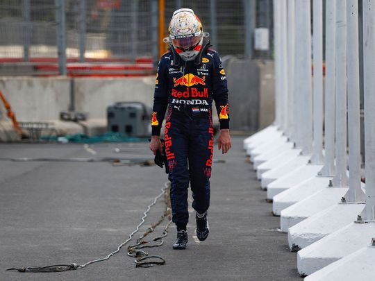 Red Bull's Dutch driver Max Verstappen walks to the pits after a crash during the Formula One Azerbaijan Grand Prix