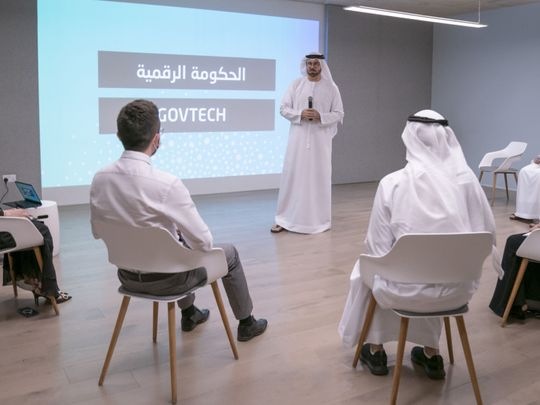 H.E. Mohammad Al Gergawi speaking to participants in the presence of H.E. Ohood Al Roumi-1623073214176