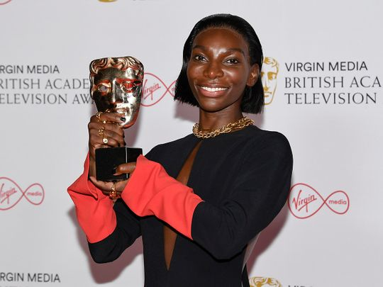 Michaela Coel poses for photographers with his Leading Actress award for her role in 'I May Destroy You' backstage at the British Academy Television Awards in London, Sunday, June 6, 2021.