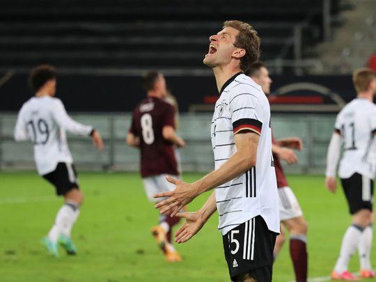 Thomas Mueller celebrates against Latvia