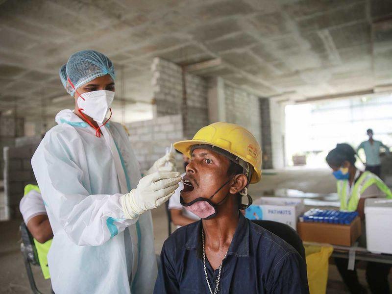 india health worker covid swab test