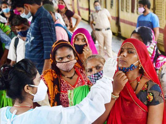 A medic collects nasal sample from a passenger at Dadar station in Mumbai.
