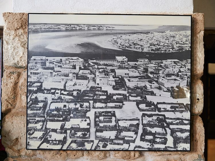 A black and white picture of Dubai creek at Bayt Al Wakeel