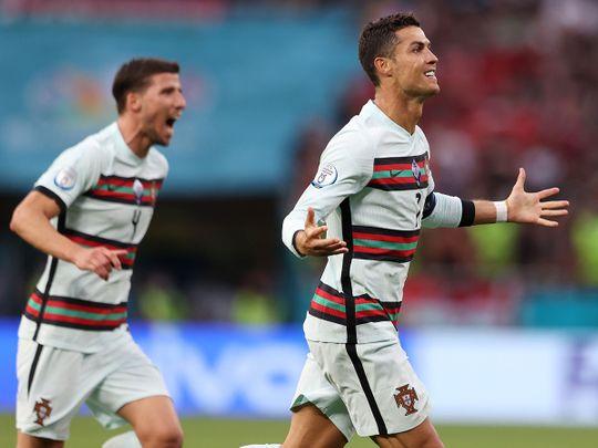 Cristiano Ronaldo celebrates scoring Portugal's third goal against Hungary at Euro 2020
