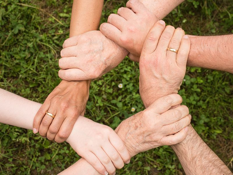 Group of people helping holding arms. Image used for illustrative purpose only