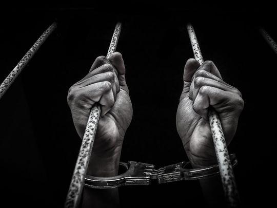 STOCK jailed prison handcuff crime