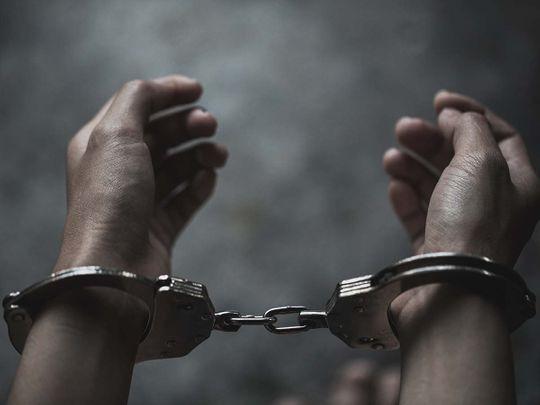 STOCK jailed prison handcuff crime arrest