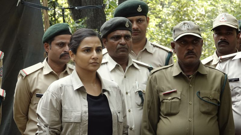 Vidya Balan with forest officers in the film-1623834316427
