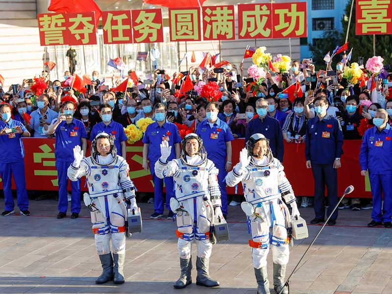 Chinese astronauts Tang Hongbo, Nie Haisheng and Liu Boming
