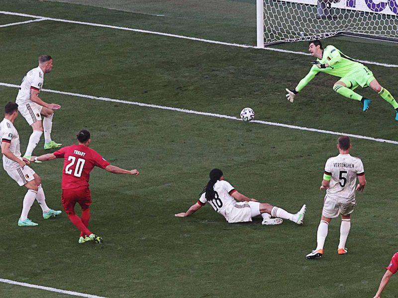 Denmark's forward Yussuf Poulsen (3rd-L) shoots and scores a goal