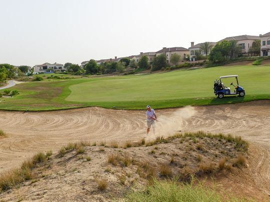 Mark Rix of English Roses plays a bunker shot at the EAGL Mini-Series on the Fire Course at Jumeirah Golf Estates