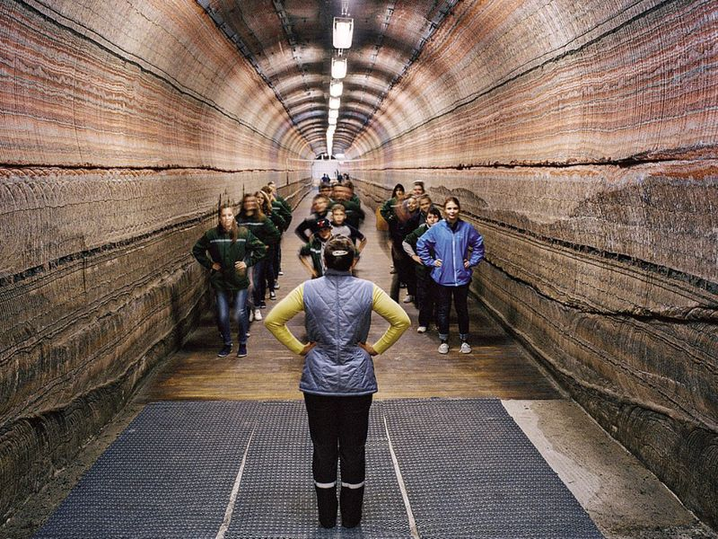 Patients in the tunnel of the National Speleotherapy Clinic, which contains purifying layers of sylvanite and salt.  Soligorsk, Belarus