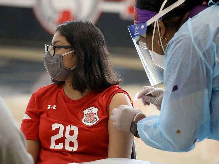 A student at Esteban Torres High School in Los Angeles receives a COVID-19 vaccination