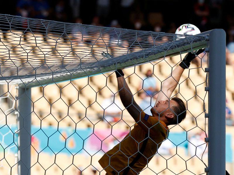 Slovakia's Martin Dubravka scores an own goal against Spain