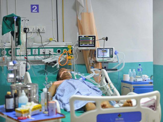 A COVID-19 patient is seen on a ventilator at Karuna Hospital