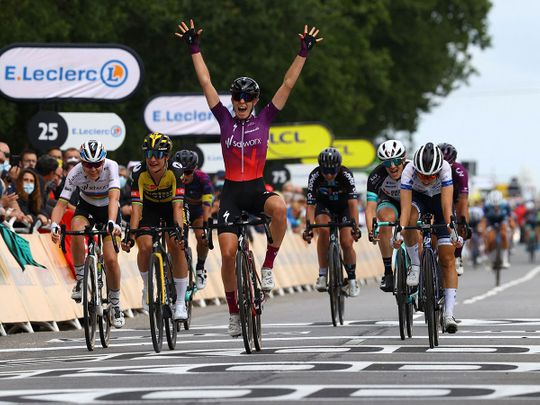 Team SD Worx rider Demi Vollering celebrates as she crosses the finish line during La Course prior to the 1st stage of the 108th edition of the Tour de France
