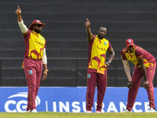 Kieron Pollard, Andre Russell and Jason Holder of West Indies set the field against South Africa