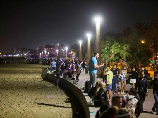 People party in Playa de Palma beach on the island of Mallorca