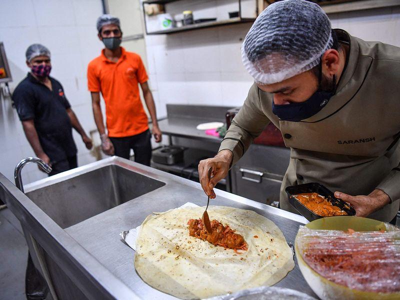 Chef Goila preparing roll in roomali roti