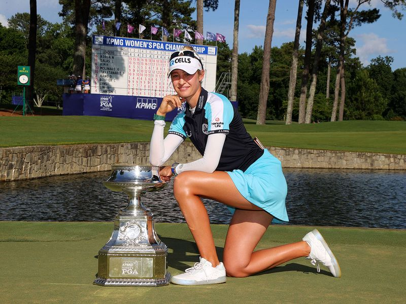 Nelly Korda poses with the trophy after winning the KPMG Women's PGA Championship