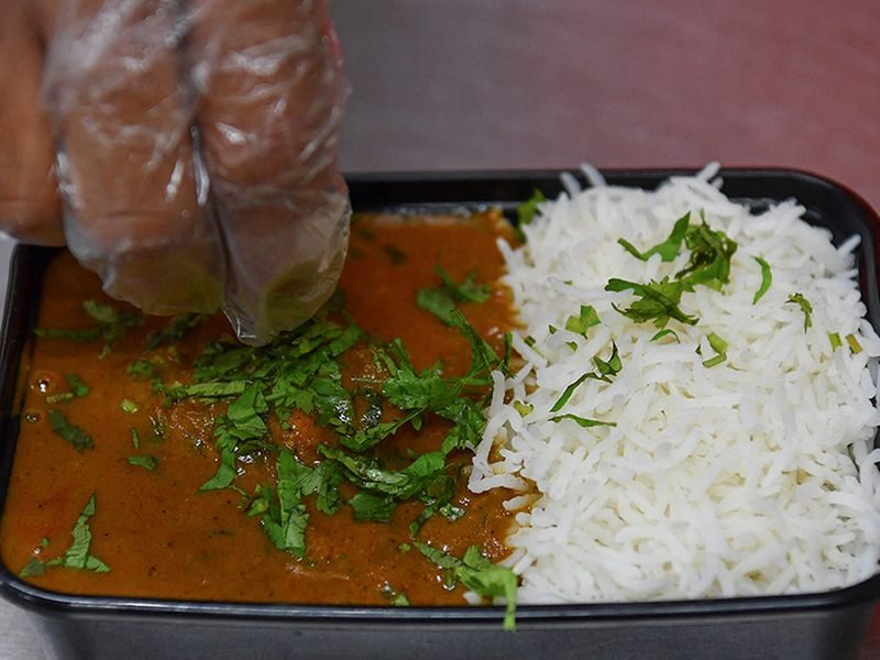 Packaging meal at Chef Goila's Kitchen