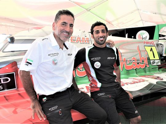 Team Abu Dhabi manager Guido Cappellini with Rashed Al Qemzi.