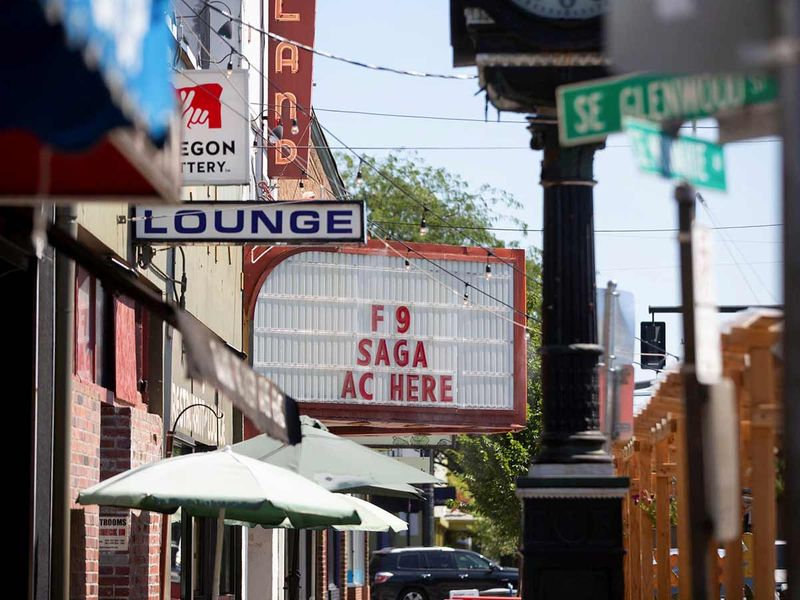 A movie theatre advertises air conditioning along with a movie during unprecedented heat wave in Portland, Oregon.