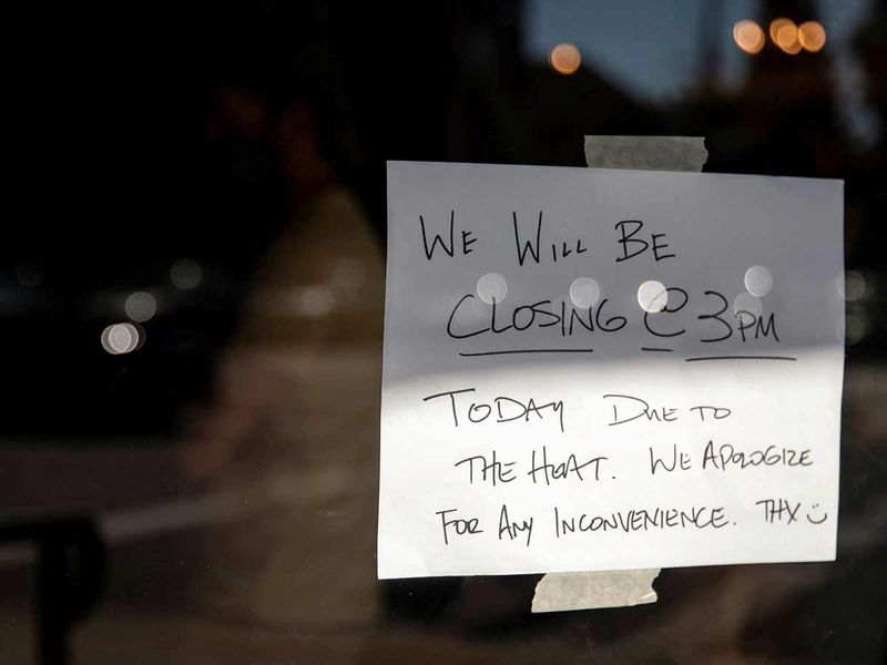 A notice is seen as a business chose to close early due to an unprecedented heat wave in Portland, Oregon.