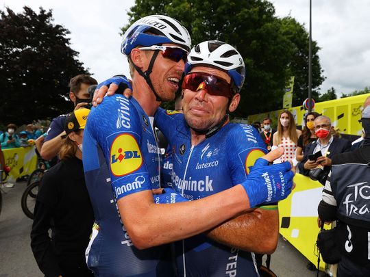 Deceuninck–Quick-Step rider Mark Cavendish celebrates with teammates after winning stage 4 of the 2021 Tour de France