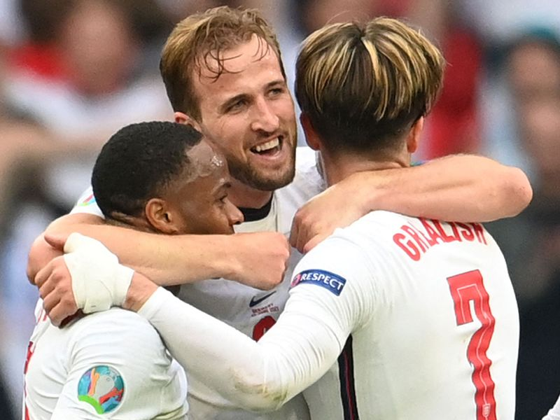 England's Harry Kane celebrates with Raheem Sterling and Jack Grealish after their win over Germany.