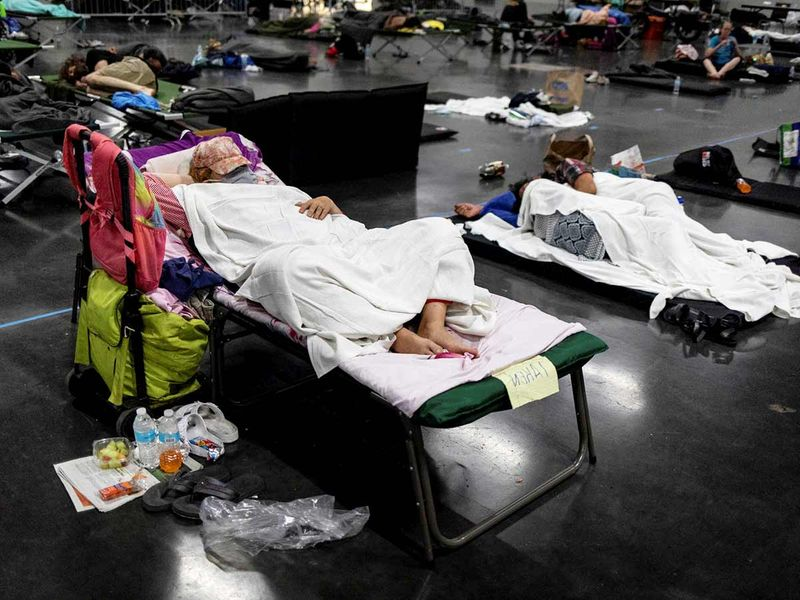 People sleep at a cooling shelter set up during an unprecedented heat wave in Portland, Oregon.