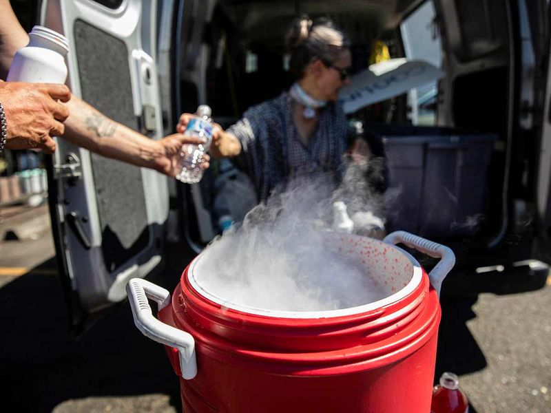 People use dry ice to cool water and Gatorade due to an ice shortage during an unprecedented heat wave in Portland, Oregon.