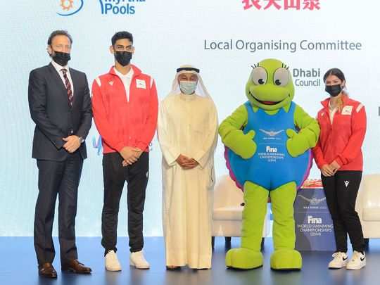 Swimmers Youssef Al Matrooshi and Layla Al Khatib with Brent Nowicki of Fina and Abu Dhabi Sports Council's Aref Hamad Al Awani and Dana the Hawksbill Turtle,  to launch the Fina Abu Dhabi World Swimming Championships.