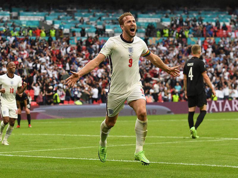 Harry Kane celebrates England's second goal against Germany